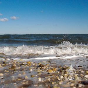 View of the Little Peconic Bay from a rock shore beach. Wave was caught splashing up from the rocky