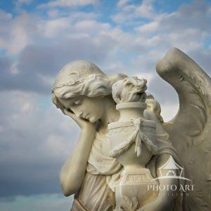 This gentle marble angel sculpture watches over all those who believe.
