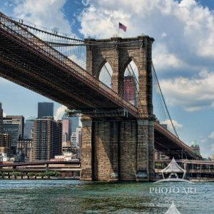 View of the Brooklyn Bridge while boating on the East River, NYC