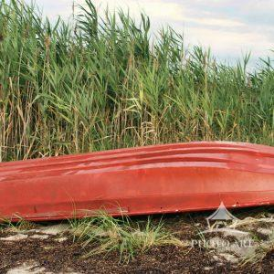 This red flat bottom row boat was resting on the banks of the Davis Park Fire Island bayside
