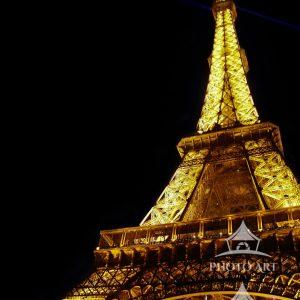 On a hazy early evening in Paris, the city of lights comes to life when the Eiffel Tower begins to