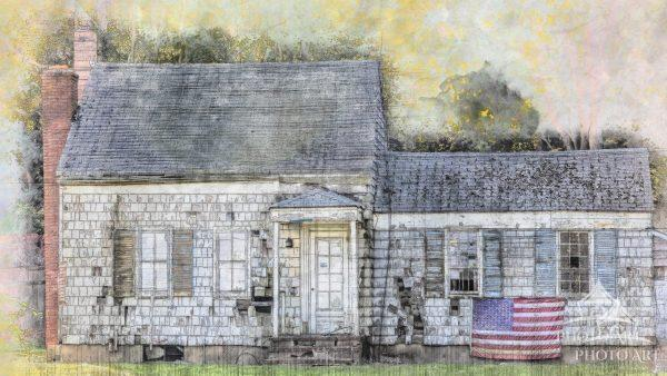 An old home on Long Island's North Fork appears to be void of life yet the American flag hangs