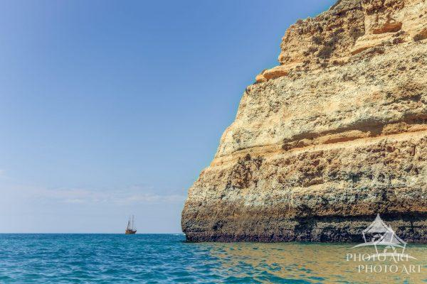 A 'pirate' ship rests off the coast of Portugal's southern coast and adds to an already beautiful