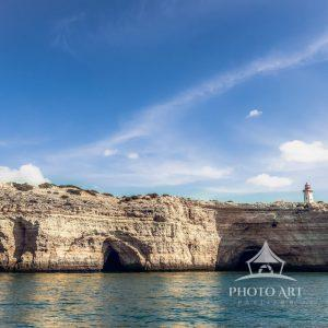 Alfanzina Lighthouse, located on the cliffs above the caves in Portugal. All are equally