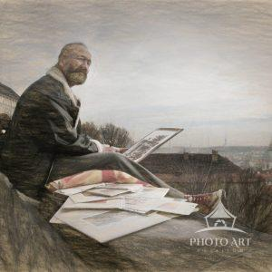 A wonderful street scene in Prague. A sketch artist sits upon a wall overlooking the capital city