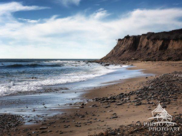 The waves gently greet the shore during a peaceful stroll along the beach in Montauk.
