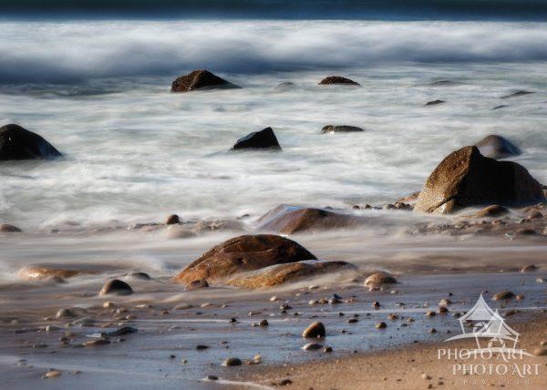 The waves of the Atlantic Ocean softly caress the shore at the Andy Warhol Preserve in Montauk.