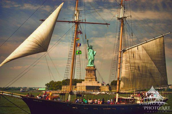 The Schooner, Clipper City, perfectly frames the Statue of Liberty on this beautiful August