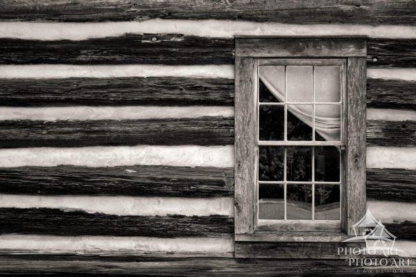 Like a time machine, the curtain pulled back on the window of this historic Nashville cabin, seems