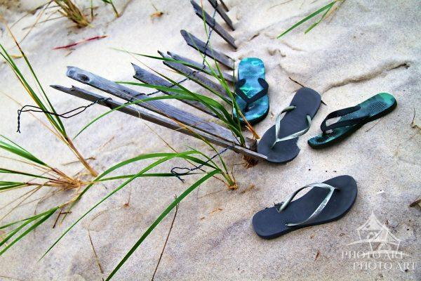 Sandals, no longer needed, wait for their owners to return from the beach for the walk home.