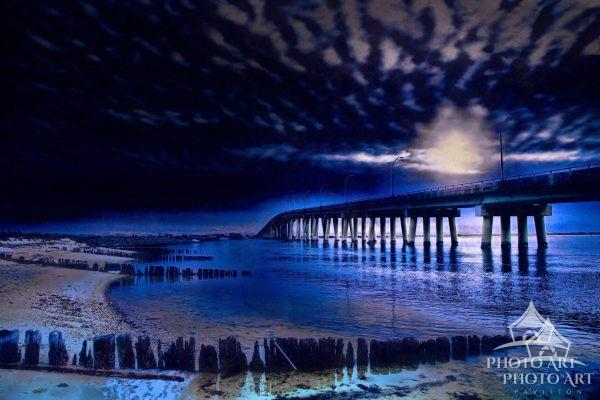 The full moon provides dramatic back-lighting for the Ponquogue Bridge in Hampton Bays, NY