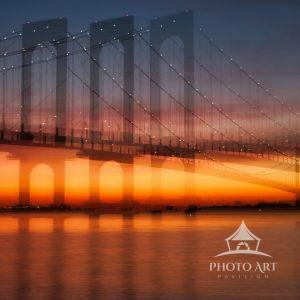 Whitestone Bridge shadows created with lens manipulation as the sun sets in the distance.