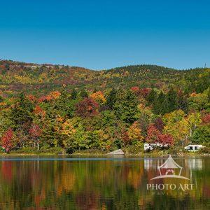 The trees and foliage that surround North South Lake are at their peak in color change with vibrant