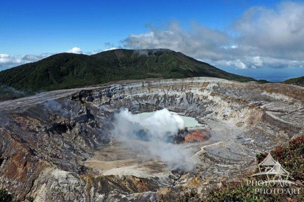 Poas Volcano if located in the Poas National Park. Steam is eminating from its crater. It last