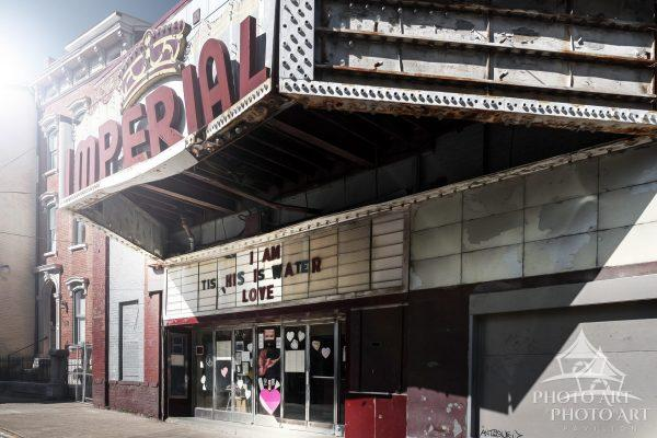 Old theater decaying on the roadside somewhere near Cincinnati Ohio. Color photograph.
