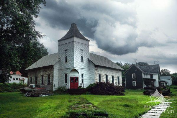 Old and seemingly converted church along the roadside in upstate New York. Small town living and