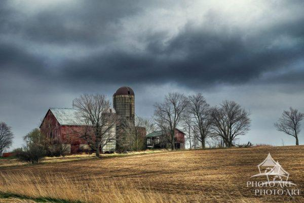 Old barn way up north in Canadian farmland. Color photograph with subtle artistic texture.
