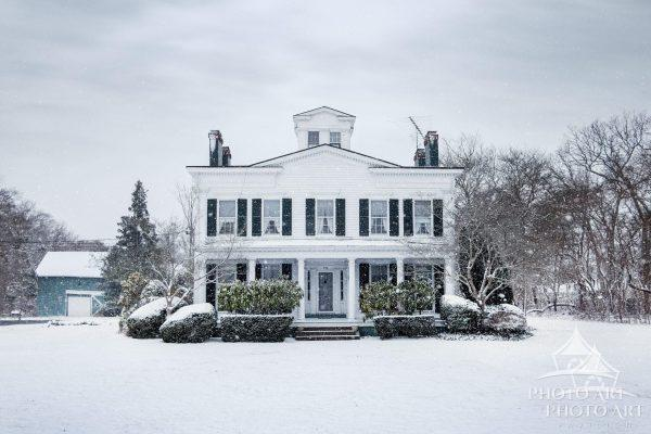 Beautiful old house / mansion in Suffolk County, NY on a snowy day in winter. Color photograph.