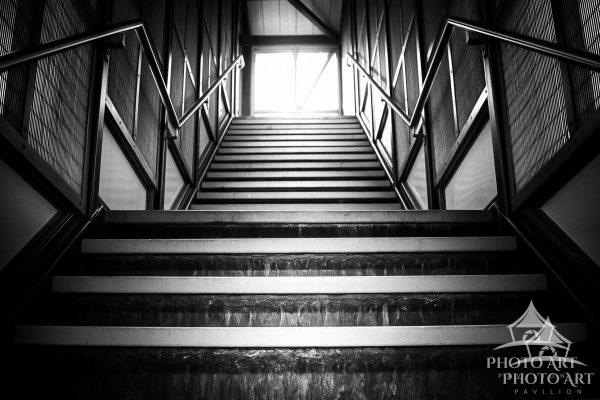 Steps at a train station in New York. Black and white photograph.