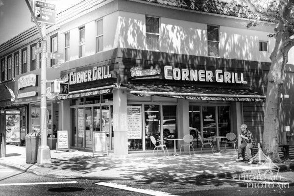 Cafe / Diner on street corner in New York City, NY. Black and white photograph with slight