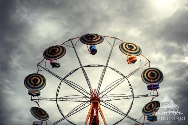 Colorful carnival ride under cloudy sky in Patchogue, Suffolk County, NY. Color photography with