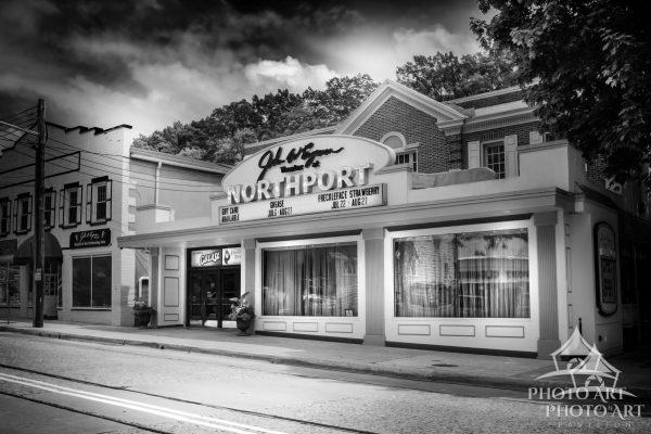 Great old theater along the street in Northport, Suffolk County, NY. Black and white photo with very