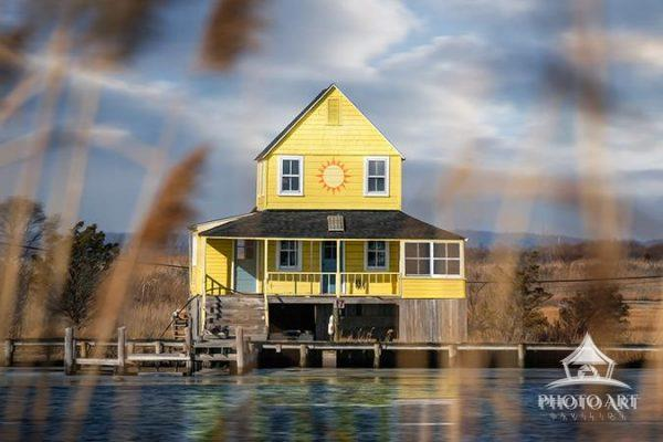 Like a scene from a storybook, this beautiful little beach house seems so happy with it's bright