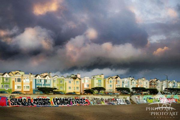 Cool clouds at sunset over colorful houses at the shore, in San Francisco, California. Color