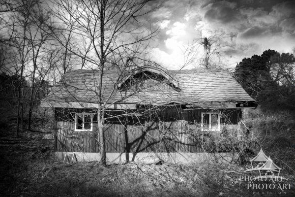 Abandoned, roadside house, left all alone on vacant property in Suffolk County, NY. Black and white