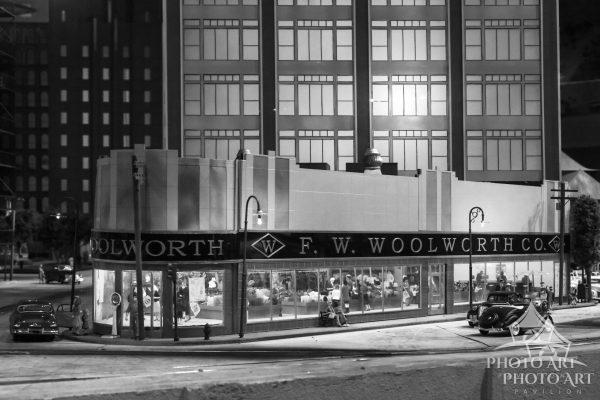 Old fashioned and vintage scene showing a miniature of Woolworths. Black and white photograph.
