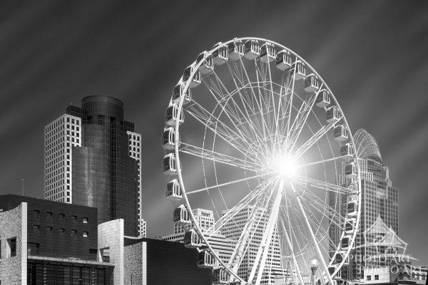 The skyline of Cincinnati, Ohio with it's large riverfront Ferris wheel. Black and white