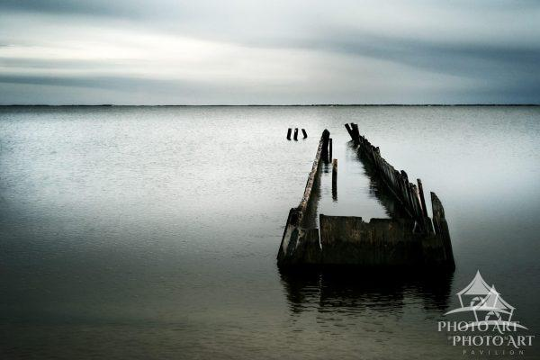An isolated, broken pier along the south shore of Long Island, decorating the Great South Bay with