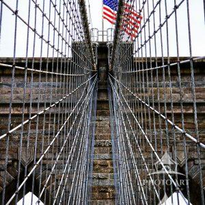 The first steel-wire suspension bridge, the Brooklyn Bridge, connects the New York City boroughs of