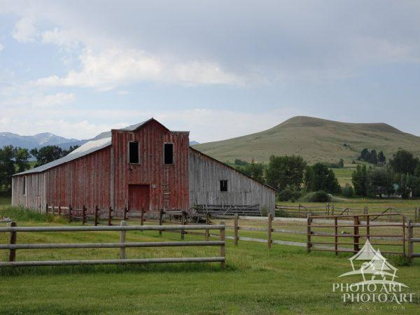 A weathered red barn on a ranch in Montana.