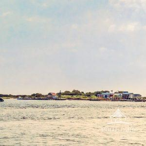 Tiny houses dot the fragile coastline at the eastern head of the state channel on Long Island's