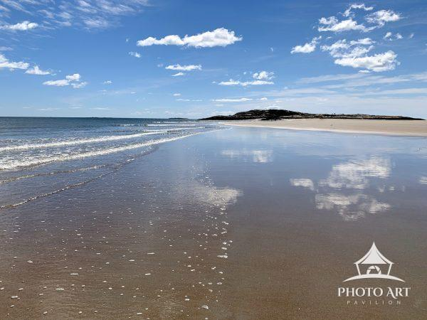 The clouds reflect off the sand as the surfs slowly comes in at Popham Beach, Maine. #newengland