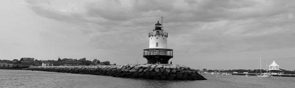 A lighthouse greets boaters entering Portland Harbor in Portland, Maine. #newengland