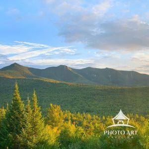 The sun sets after a beautiful afternoon behind the White Mountains in North Conway, New Hampshire.