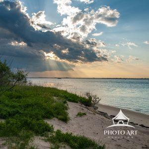 It was an impressive moment when the sun rays poked through the clouds. I just love photographing a