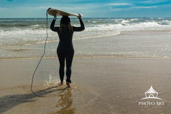 A surfer gets ready to catch a wave at Ditch Plains Beach in Montauk, NY