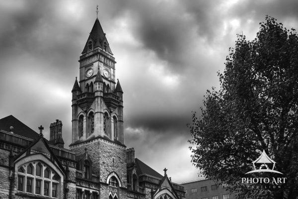 Wonderful old church steeple under dramatic clouds in Nashville, Tennessee. Black and white