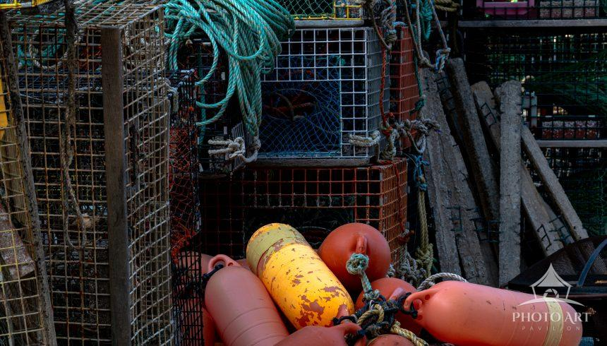 Lobster Traps and Buoys on working lobster dock in Port Clyde Maine.