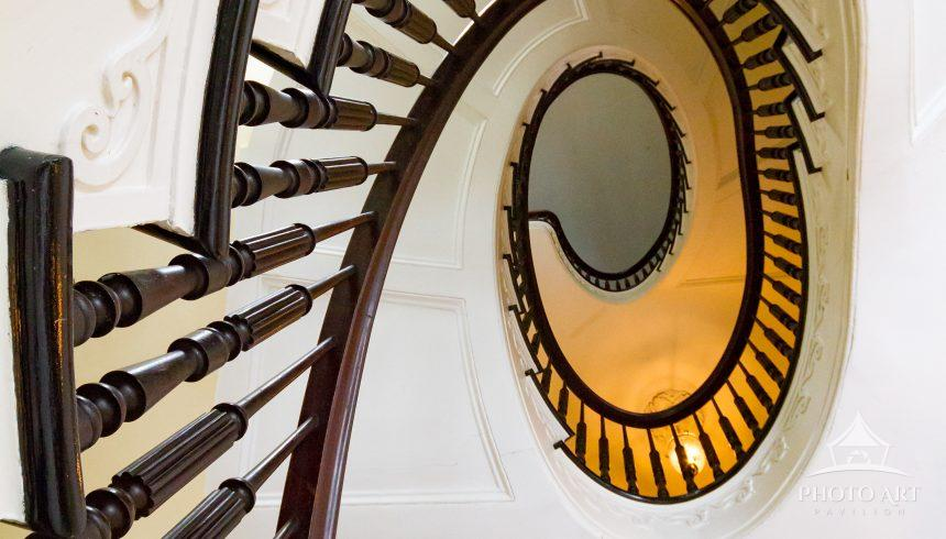 Looking up historic staircase at Bartow-Pell Mansion