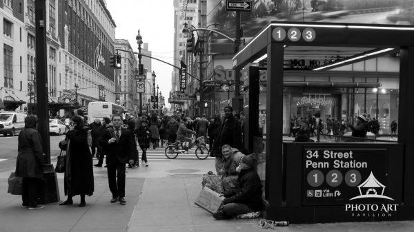 This image in black & white at the intersection of Seventh Avenue and 34th Street in Manhattan