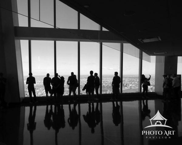 Visitors to the observation deck of the Freedom Tower in NYC have a panoramic view of Manhattan,