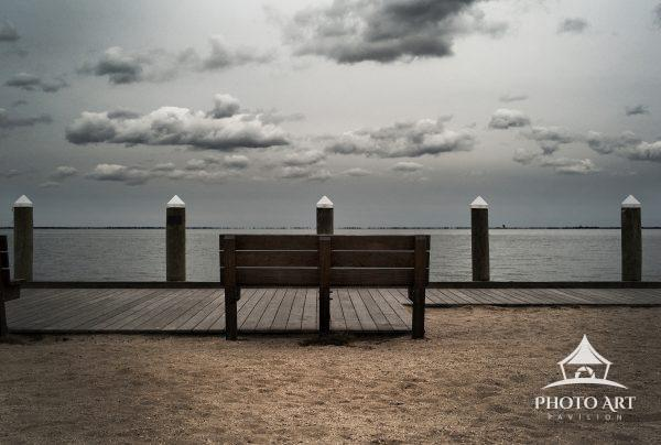 Lonely bench along the boardwalk, overlooking the Great South Bay near Bay Shore, NY. Beautiful