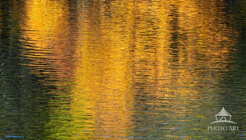 An early morning hike in the Adirondacks leads to vivid autumn reflections along the banks of the