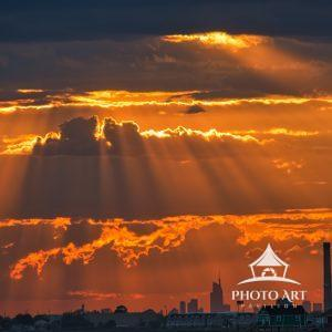 A spiritual sunset is created with mystical clouds and brilliant sunrays.