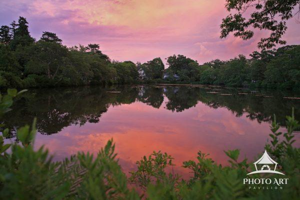 Sunset reflecting off of a lake in Brightwaters, Long Island