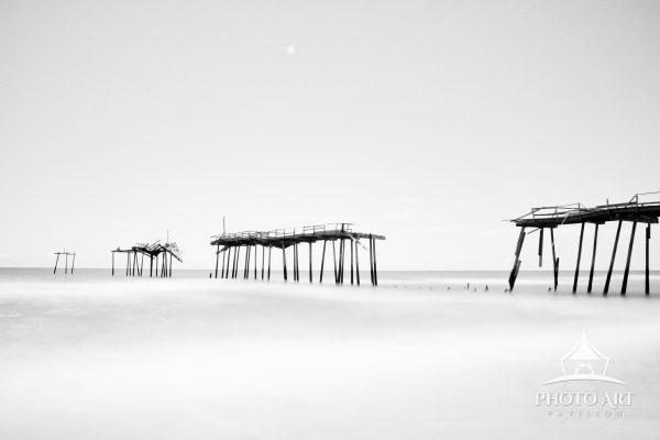 Leftovers of old and abandoned Hatteras Pier in North Carolina still standing.